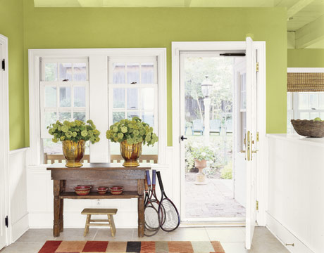 Putting apple green on the walls in an entryway makes for a bright and refreshing welcome to your home. I like the contrast of the apple green and the bright white wainscoting.