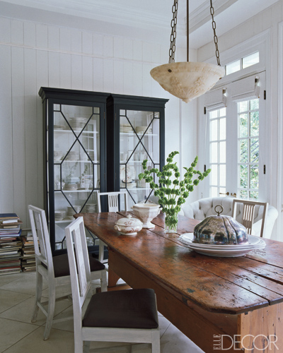 Another of Darryl Carter's beautifully polished rustic spaces. I love pairing white chairs with unfinished wood tables. Lost are the days of matching table sets.
