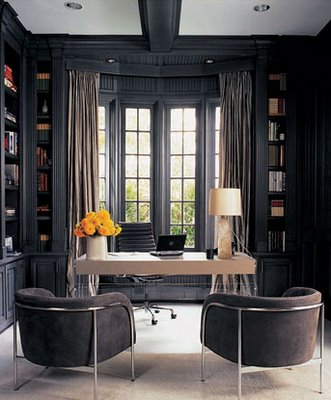 Designer Monique Lhuillier's office. The beautiful dark slate color creates a monochromatic palette, allowing the white desk to serve as the centerpiece of the room.