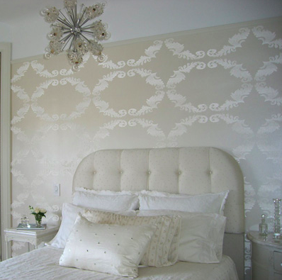 I love this bedroom! This is a perfect example of how the addition of texture, pattern, and an accent piece can make a monochromatic white space beautiful and elegant.