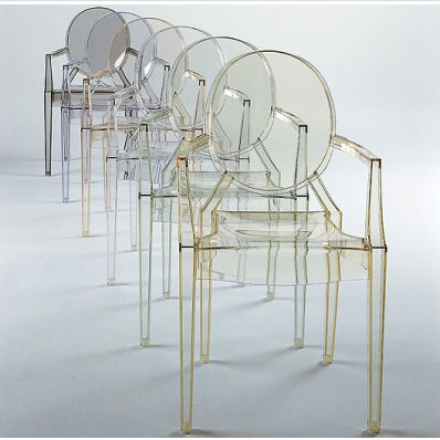 Kartell's Louis Ghost Chairs. They come in a number of different opaque colors.
