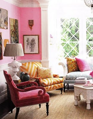 When using pink you are not confined to one shade. This living room uses a variety of different pinks...bubblegum pink walls, bright pink pillows, and a deep rose pink velvet armchair. The variety of colors and patterns creates an alluring eclecticism.