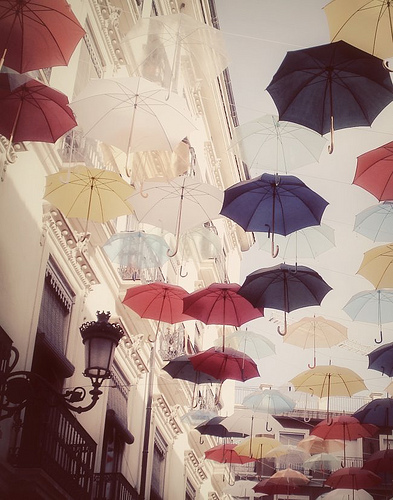 Umbrellas in France. Such an amazing photo! I wish I knew who the photographer was.