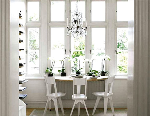 You can get away with having an all white space with in a light filled room. The natural light makes the space bright and refreshing. I love the unique shape of the chairs and the half-moon table...great for a small kitchen.