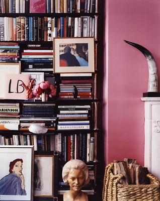 Miles Reed. Designers often hang pictures on a bookcase, using the books as the backdrop.