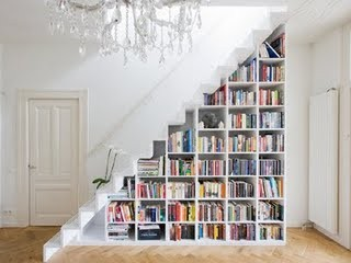 This is one of my favorite spaces. Filling the bookcase with books emphasizes the steep angle of the staircase; immediately drawing your eye to the triangular shape it creates. This is a great example of how the addition of books can give a space color, visual interest, and geometry.