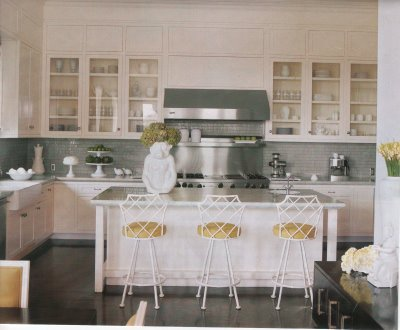 Decor Pad. This is my absolute favorite kitchen, combining all of my favorite design elements in one space...bamboo chairs, slate gray accents, subway tiles, white carrara marble countertops, neutral upholstery, and high sheen maple wood floors. An absolutely beautiful kitchen that is both elegant and functional