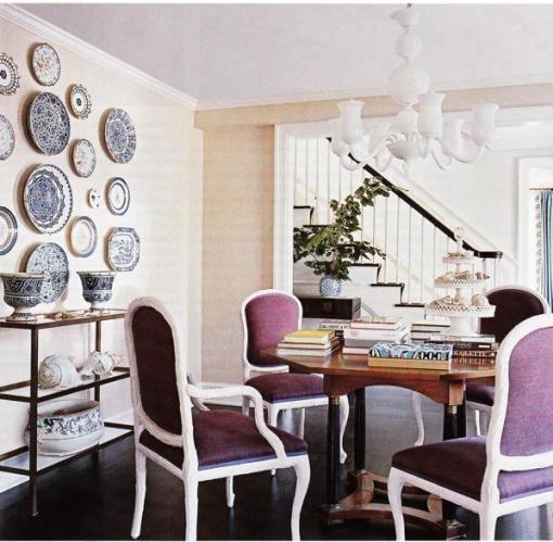 Purple upholstered dining chairs is an easy way to add a touch of color, and I love the look of white dining chairs with a natural wood table. The purple also adds a touch of royalty to the entire dining experience.