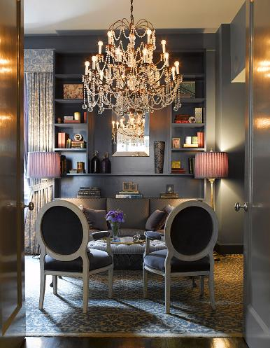 Molly Sim's dining room is unquestionably chic with the oversized chandelier and addition of high sheen silver walls. Slate gray is a great complementary color to purple, bringing out the bluish tones inherent in purple.