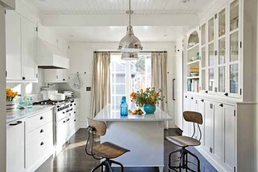 Portland Monthly. The pendant lights and wood lab chairs add just the right amount of industrialism to this bright all-white palette.