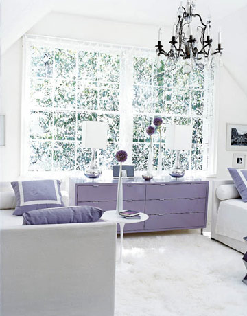 This room uses such a simple color palette of white and lilac, and yet it is very elegant and sophisticated. The black antique chandelier adds a gothic feel to the otherwise contemporary space.