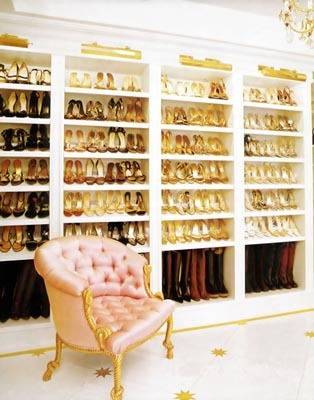 Mariah Carey's shoe closet looks more like a department store than a closet space. The shoes are so beautifully arranged that they become part of the decor and complement the other gold accents in the silk tufted chair, marble floors, and chandelier.