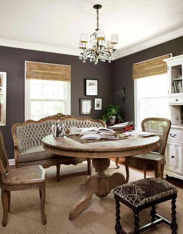 I absolutely love this dining nook! This is a great example of the versatility of gray. Although the designer chose a bold gray for the walls, it serves as the perfect neutral backdrop to the more rustic chic feel of the space. Notice how the gray walls and the gray settee brings out the ashy gray in the unfinished wood.
