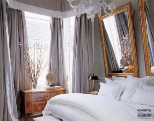 This still ranks as one of my all-time favorite bedrooms. I love how the drapery frames the window and falls almost messily to the floor. The gold frames and the all white bedding are so simple, and yet give the space the perfect dose of elegance, sophistication and femininity.